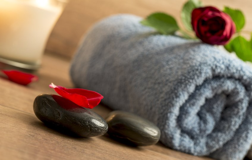 Romantic Atmosphere With A Red Rose On Top Of Rolled Towel, Lit
